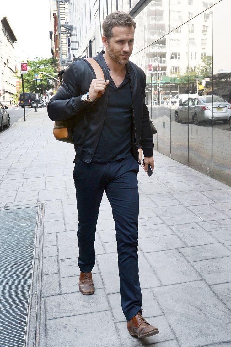 The Week in Style: 07.10.15 | GQ Ryan Reynolds casual Friday, navy monochrome, black leather bomber jacket, pants, Henley, backpack brown shoes