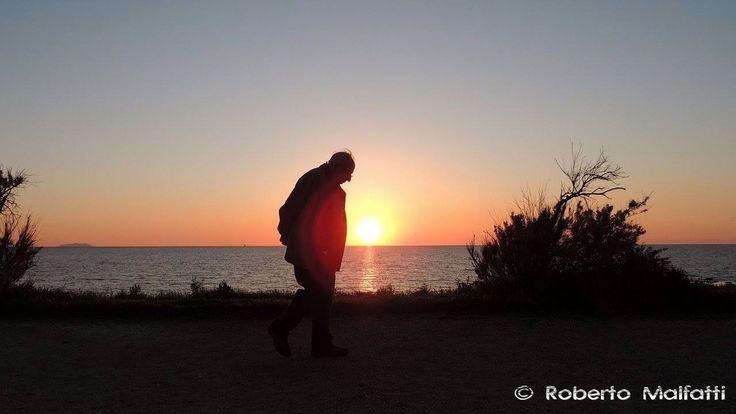 Old man walking at sunset #sunset