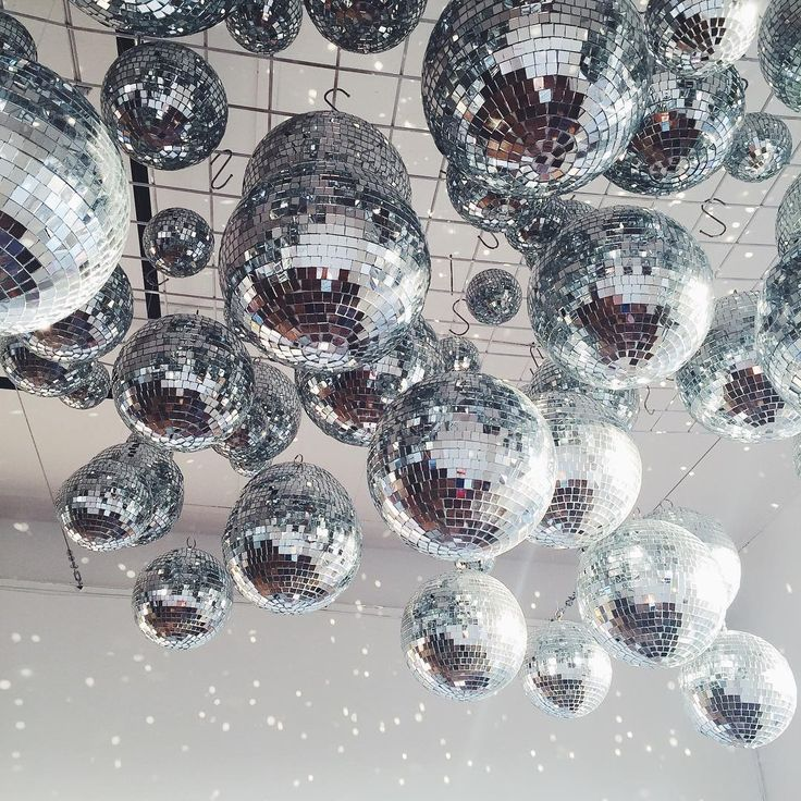 Ceiling covered in disco balls - fun & unique wedding decor idea!