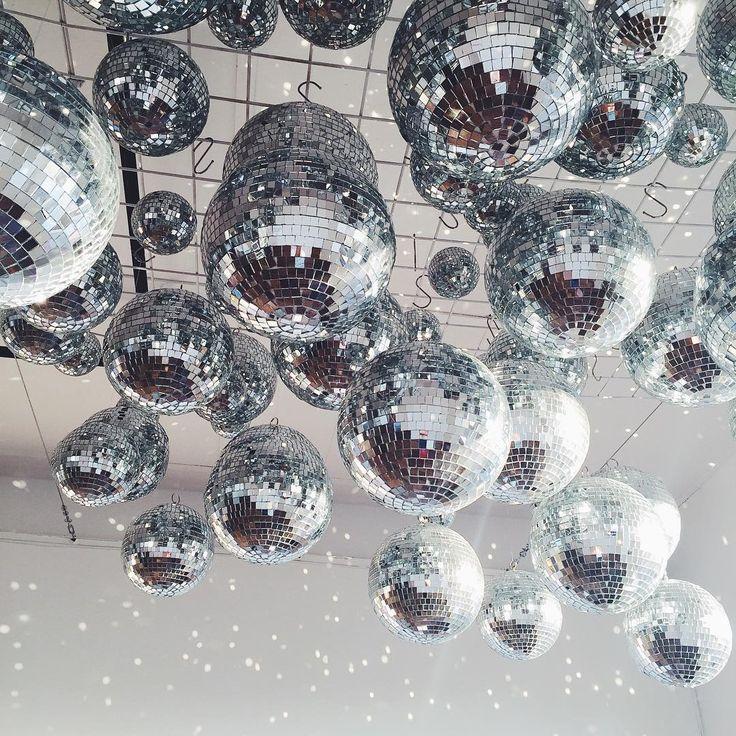 Ceiling covered in disco balls - fun & unique wedding decor idea!