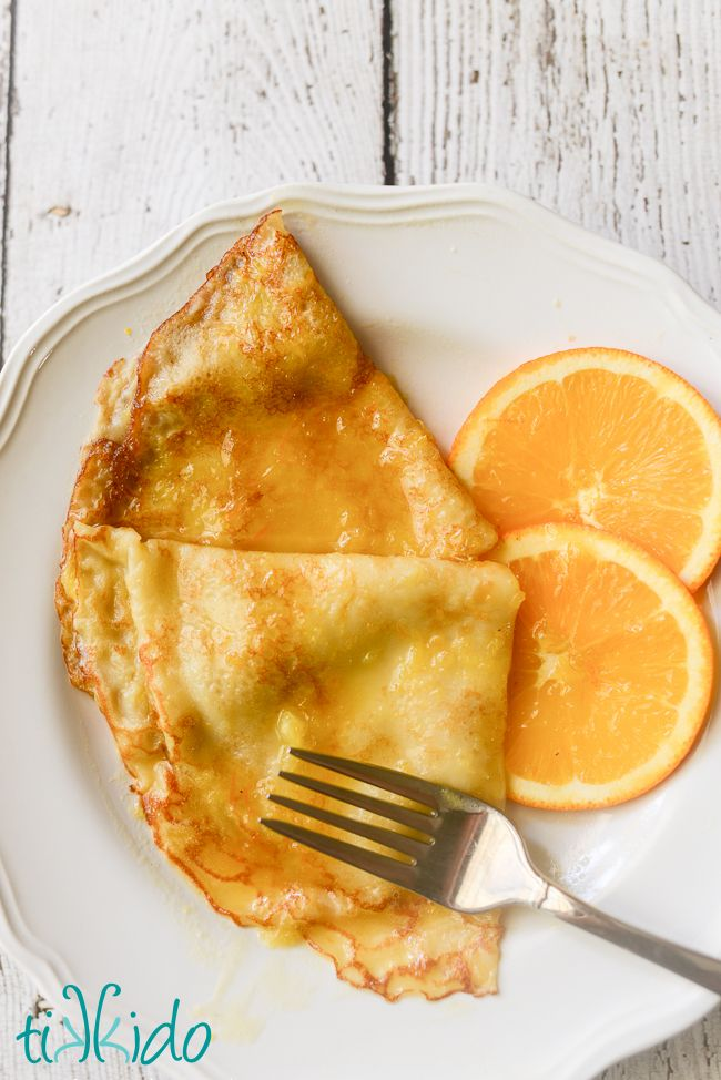 Classic crepes Suzette recipe.  The decadent, buttery orange sauce is amazing…