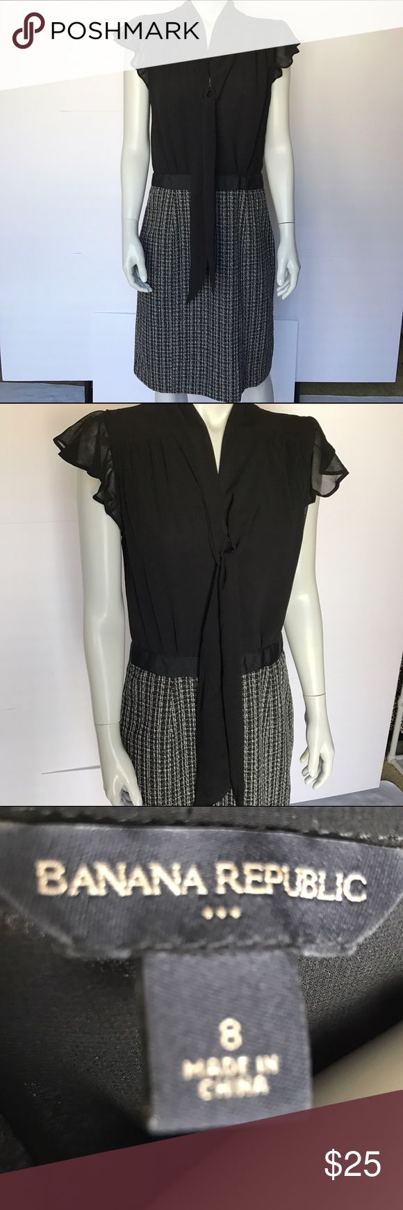 Banana Republic black and white dress Gorgeous short sleeve dress! Black chiffon material at the top - ties at the bust. Comes in at the waist for a feminine, flattering fit. On the bottom part, it is a different texture with black and white pattern. Excellent dress for professional work settings or for other occasions. Banana Republic Dresses Midi