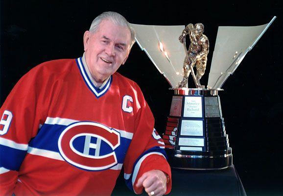 """Le trophée Maurice Richard est le nom d'un trophée de hockey sur glace en Amérique du Nord. Le trophée est un don du club des Canadiens de Montréal à la Ligue nationale de hockey en 1999, afin de récompenser le joueur ayant marqué le plus de buts lors de chaque saison régulière - The Maurice """"Rocket"""" Richard Trophy is awarded annually to the leading goal scorer in the National Hockey League (NHL). It was donated to the NHL by the Montreal Canadiens hockey club in 1999."""