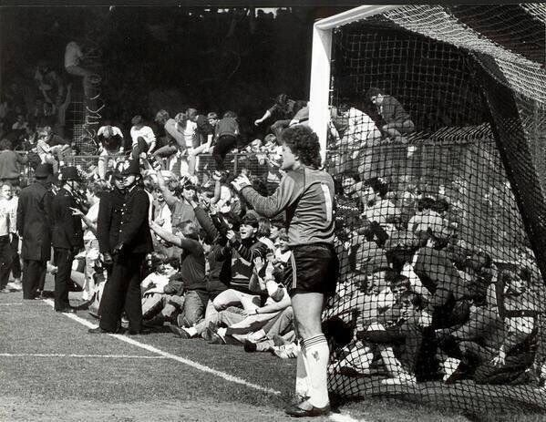 Chelsea fans take over Blundell Park as they secure the Division 2 title against Grimsby Town in 1984