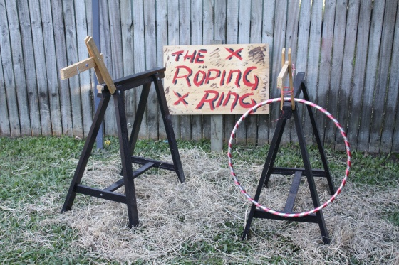 Wild west party roping ring made out of saw horse horses and hoola-hoops #cowboy #wildwest #party