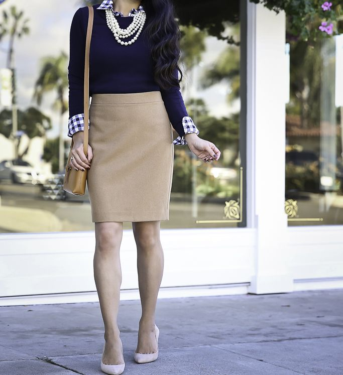 Preppy fall work outfit idea -camel wool pencil skirt gingham shirt navy sweater