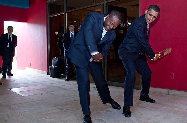 World-famous cricket legend Brian Lara shows President Obama how to properly swing a bat on April 19, 2009. White House photo by Pete Souza