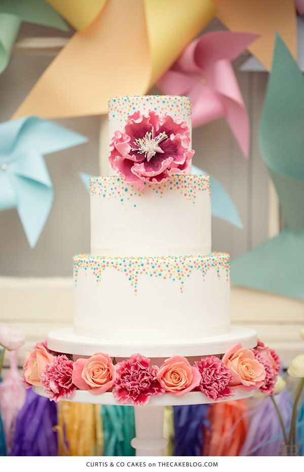 10 Confetti Throwing Cakes  | including this design by Curtis & Co Cakes | on TheCakeBlog.com