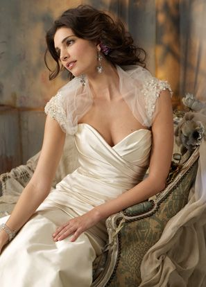 Maybe a bit too mature, but I like the lace around the shoulders. Maybe something to that effect for the ceremony.