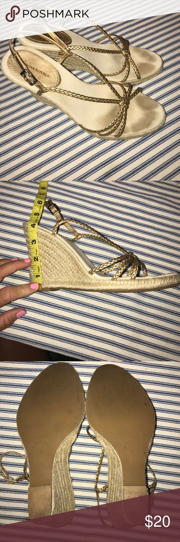 Banana Republic Gold Espadrille Wedge Sandals The perfect summer espadrilles! The braided gold straps are a perfect complement to shorts, skirts or dresses. The only evidence of wear is on the canvas footbed where there are toe markings. These may be able to be cleaned up, but the aren't noticeable when they on being worn. Banana Republic Shoes Espadrilles