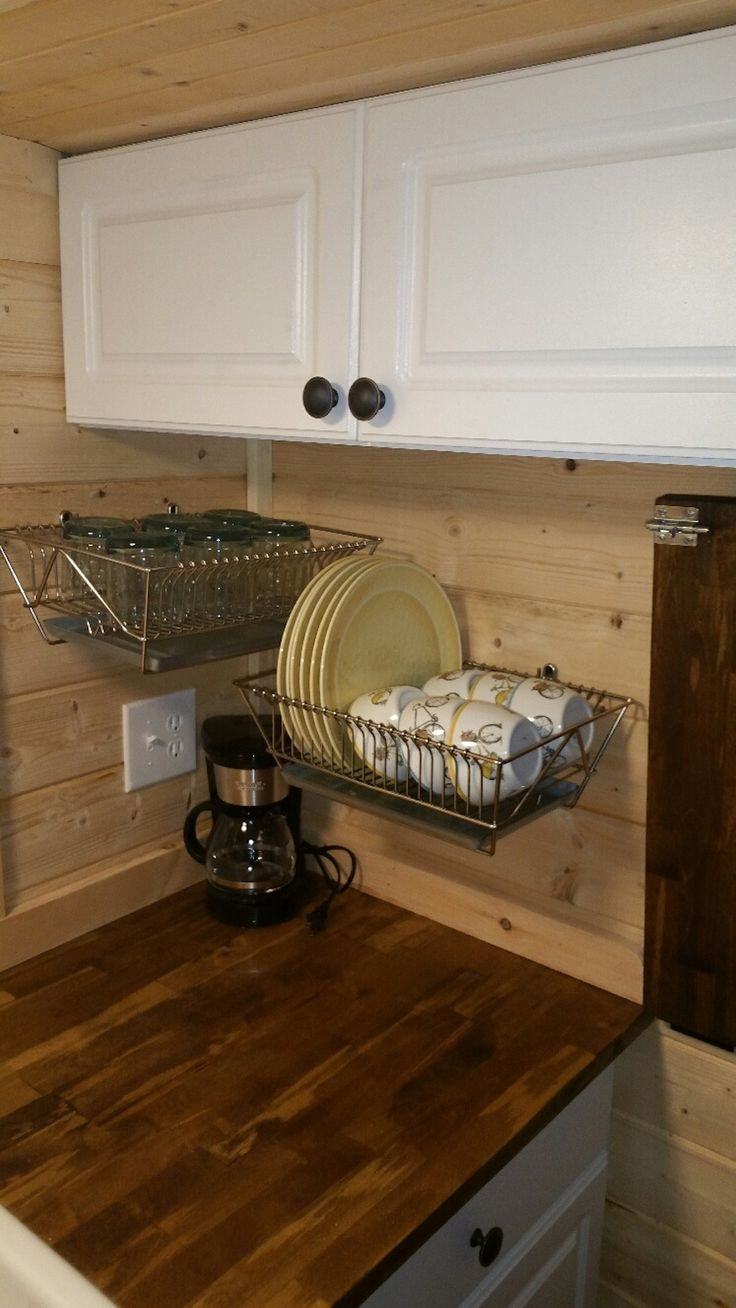 dish drainer also storage (notice bread pan underneath to catch drips) For Michael - drainer is their storage 2in1