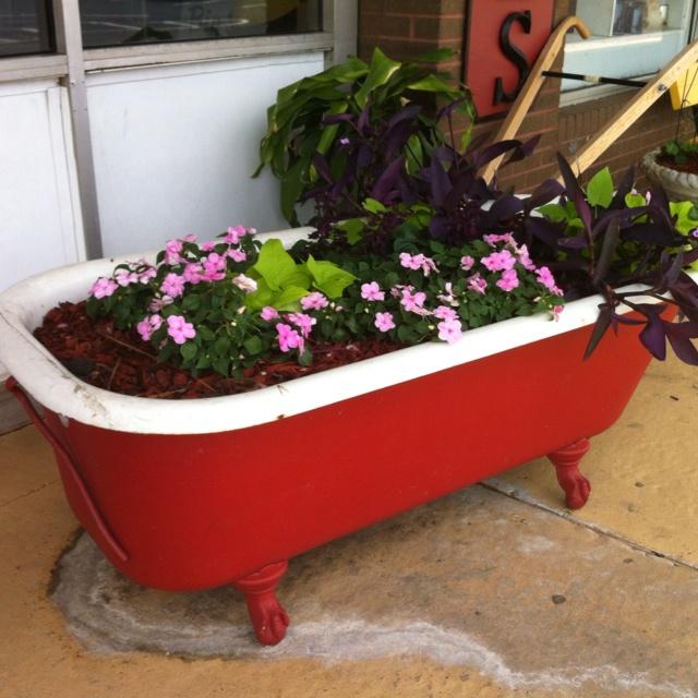 Great reuse of an old cast iron bath tub! #DIY #gardentub