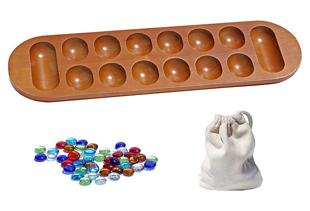 The captivating African Stone game, also known as Mancala, is an ancient game that was played by scooping out pits and calas in the sand. Many historians believe that Mancala is the oldest game in the world. This stunning set includes a walnut board and colored glass stones. It's a stimulating game for adults and kids alike.