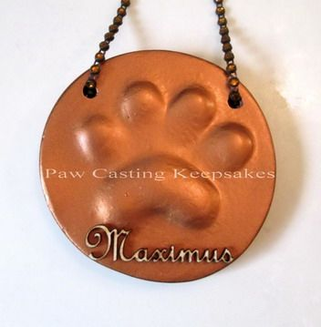 Paw casting ornament in copper and custom die cut name