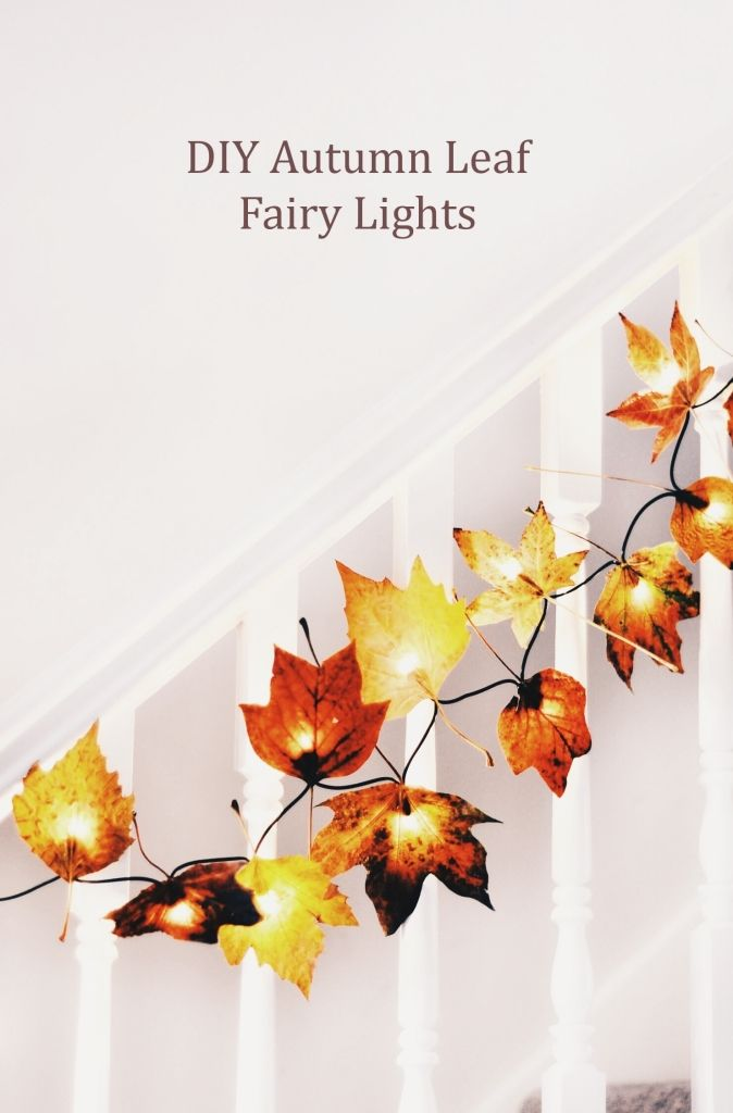 Add fake leaves to fairy lights to decorate your home for fall.