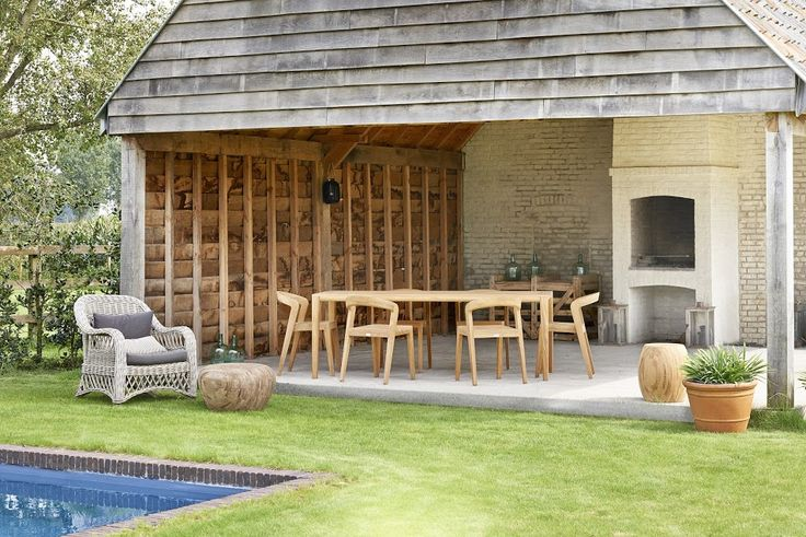 The Play Chair and Table are beautifully showcased in this rustic backyard.