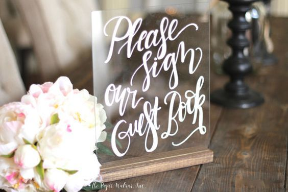 Sign here please! Crushing on these hand printed acrylic signs @mulberrymarketdesigns via @etsy by Kyle and Josh. Day's 2 guestbook inspiration is all about decor and the little things; the calligraphy on plexiglass add a modern yet classic touch to your guestbook table. Add  extra florals on the table to soften up the tablescape.