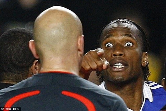 Didier Drogba rages at referee Tom Henning Ovrebo  after Chelsea were knocked out