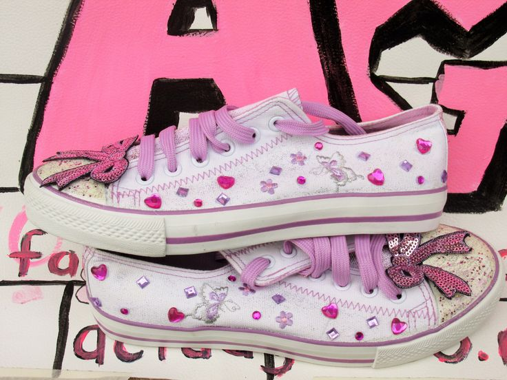 Cute, customised shoes. Hearts , bows and glitter. It doesn't get much cuter than these.