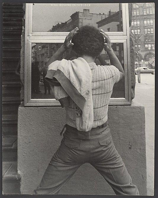 Street Scene: Young Man Fixing Hair in Window, New York City  Hipsters, Hustlers, and Handball Players: Leon Levinstein's New York Photographs, 1950–1980