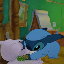 Stitch. In pajamas. Cuddling a turtle. You will never again see anything as cute. Done.