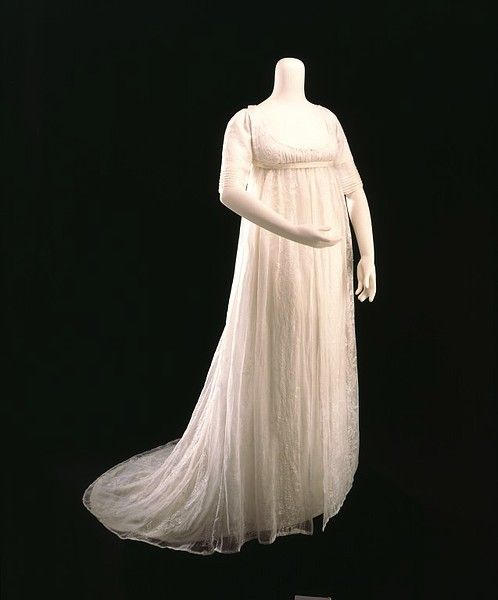 This gown is made of very fine muslin embroidered with a floral pattern. The sheer fabric did not offer much warmth, so these gowns were frequently worn under cashmere shawls draped over the shoulders and arms.