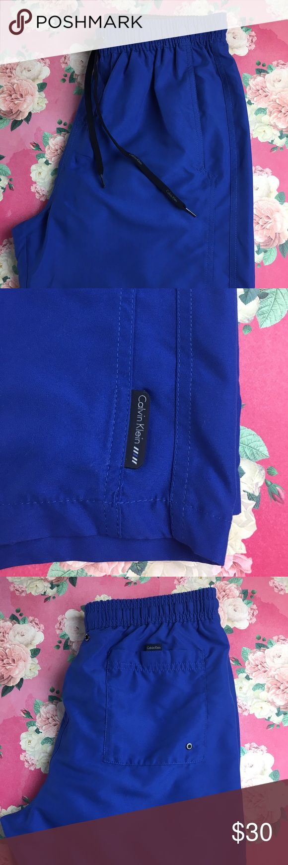 Calvin Klein Swim Shorts Size medium royal blue swim shorts. 19 in from waistband to bottom. One back pocket with Velcro closure. Two front pockets. ⭐️⭐️Bundle and save! Calvin Klein Swim Swim Trunks