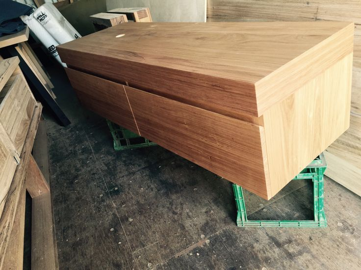 custom made australian chestnut timber wall hung vanity with shadowline fingerpull drawers