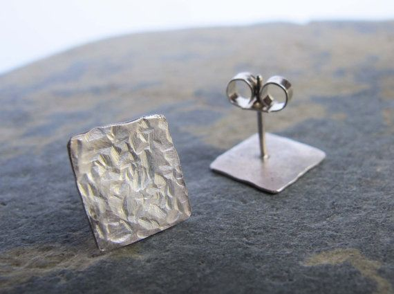 These stud earrings are handmade from sterling silver in my London studio, they have a sterling silver post and butterfly back. The silver