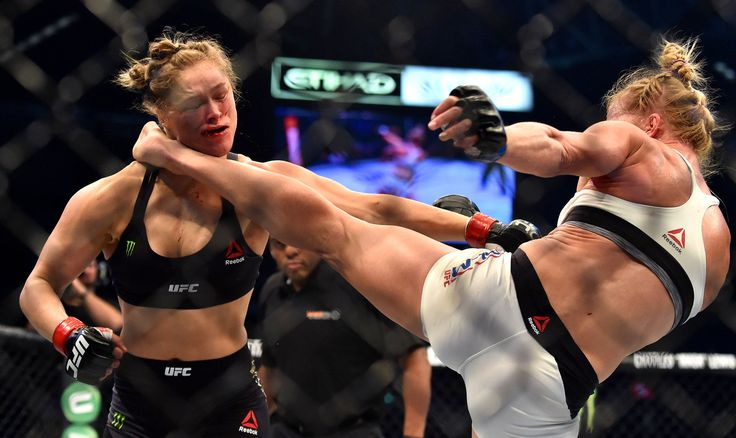 Holly Holm lands a solid kick to the neck of Ronda Rousey during the second round, knocking her out to win the UFC Women's bantamweight championship belt at UFC 193 in Melbourne on Saturday.