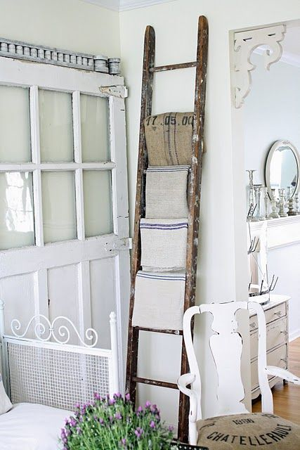 love the ladder with linens - from French Larkspur
