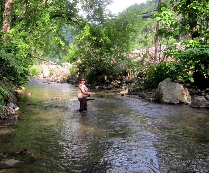 Me fishing with hubs in elkhorn creek near the elkhorn for West virginia fishing