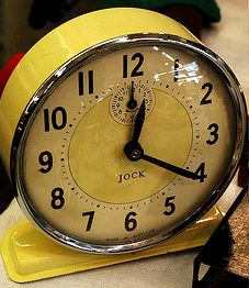 Retro clocks in vintage colours are a nod to the time period without being too over the top.