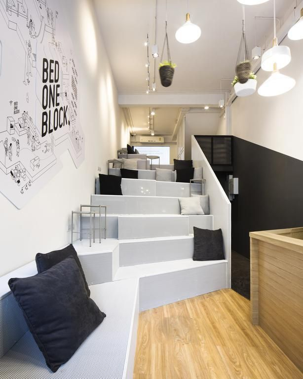 Bed One Block Hostel Design - Hang out. This slimlined hostel design in Bangkok, Thailand is genius!