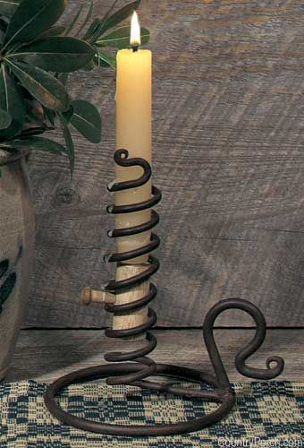 Early American fathers could regulate the amount of time suitors spent courting their daughters by adjusting the height of the candle. This authentic replica by Park Designs is hand forged in cast iron.