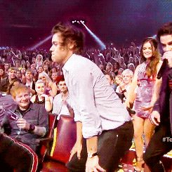 Most people will watch this gif and see Harry Styles twerking, possibly even Ed Sheeran laughing behind him, but I, all I see is R5 in the back!