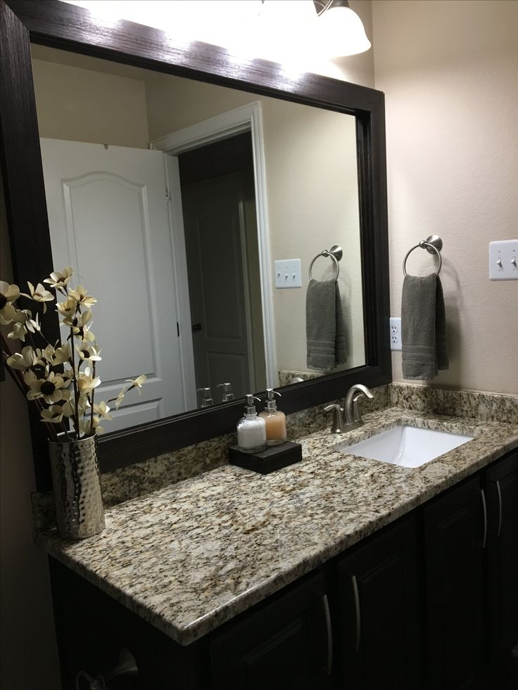 Santa Cecilia Granite and dark cabinets - bathroom