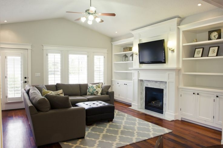 Fireplace with built-ins and fabulous moldings all around.  Click on photo to see the befores..