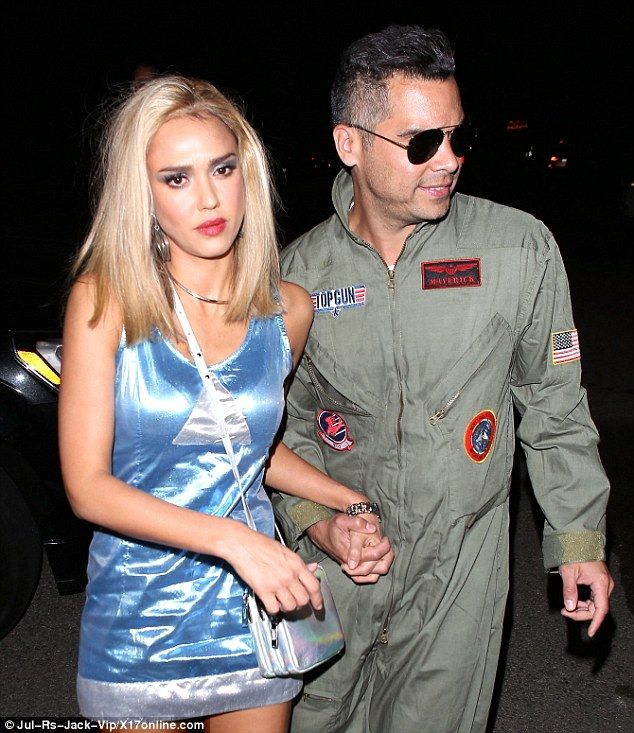 Dress up: The 34-year-old actress channeled the quirky glamour of 1997 cult classic Romy and Michele's High School Reunion while Cash, 36, went for Tom Cruise's pilot look in iconic hit Top Gun