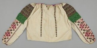 Type:	Clothing - Garment Object Name:	Blouse Place Made:	Europe: Eastern Europe, Balkans, Romania People:	Huzul ? Period:	Early 20th century Date:	1900 - 1930 Dimensions:	L 53 cm x W 146 cm Materials:	Cotton; wool; metal thread