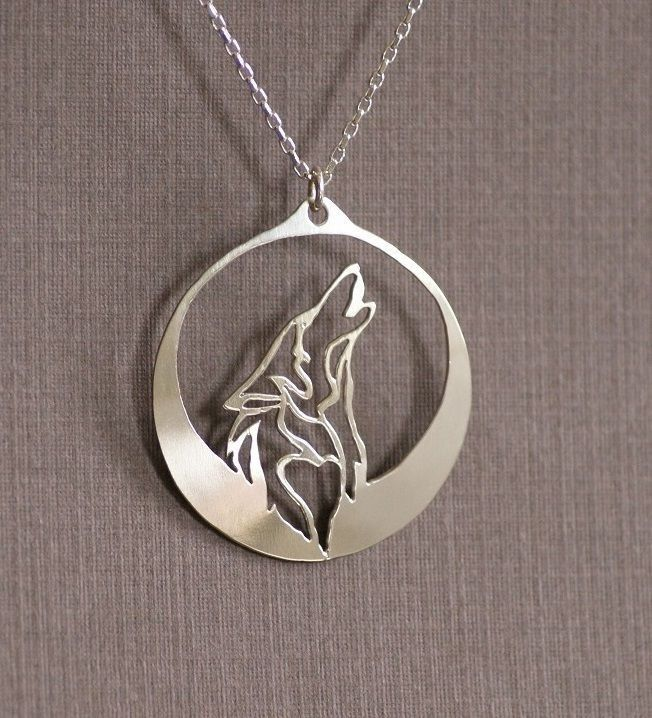 Howling Wolf Necklace The wolf howls into the inky darkness of night as its majestic profile is captured under the light of a glowing silver moon. - Pendant Size: 2.5 x 1.5 cm in Length - Chain Type: