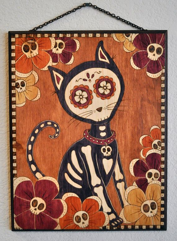 "Day of the Dead inspired wood burning of a cat, ""Skelekitty"" on Etsy, $400.00"