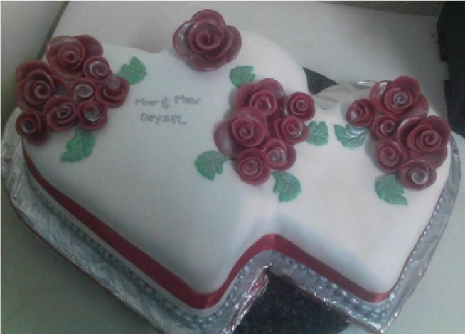 Hearts Wedding cake by Fairyfield Cakes, Roses hand crafted from Modeling Chocolate. fairyfield@live.com 0839427354