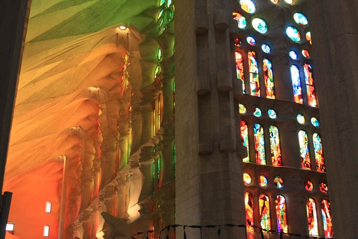 What to see in Barcelona? The filtered lights flowing in from La Sagrada Familia Windows! Reds for the Naixemento Facade and Blues for the Passio Facade!