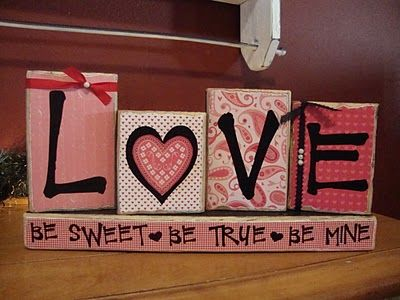 DIY V-day blocks  -scrapbook paper  -wood blocks  -letters  -modge poge. Maybe Kim can teach me?????