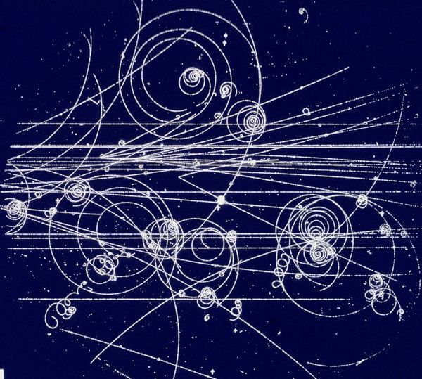 Tracks left by charged subatomic particles in a bubble chamber -- does this not look like Gallifreyan?