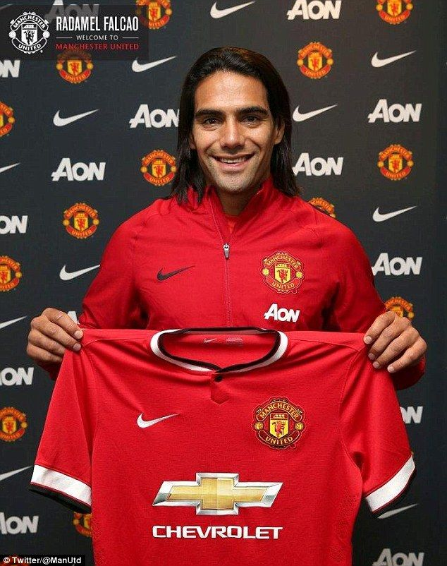Pose: Radamel Falcao holds his Manchester United jersey aloft after completing a season-lo...