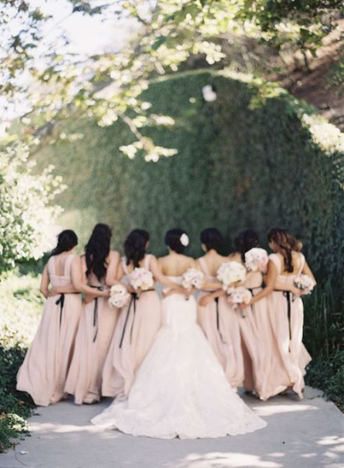 I love the idea of seeing the back of our dresses and maybe with the girls bouquets in the back too
