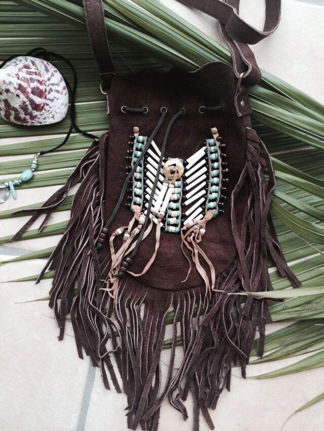 A personal favourite from my Etsy shop https://www.etsy.com/au/listing/185472662/brown-suede-fringe-bag