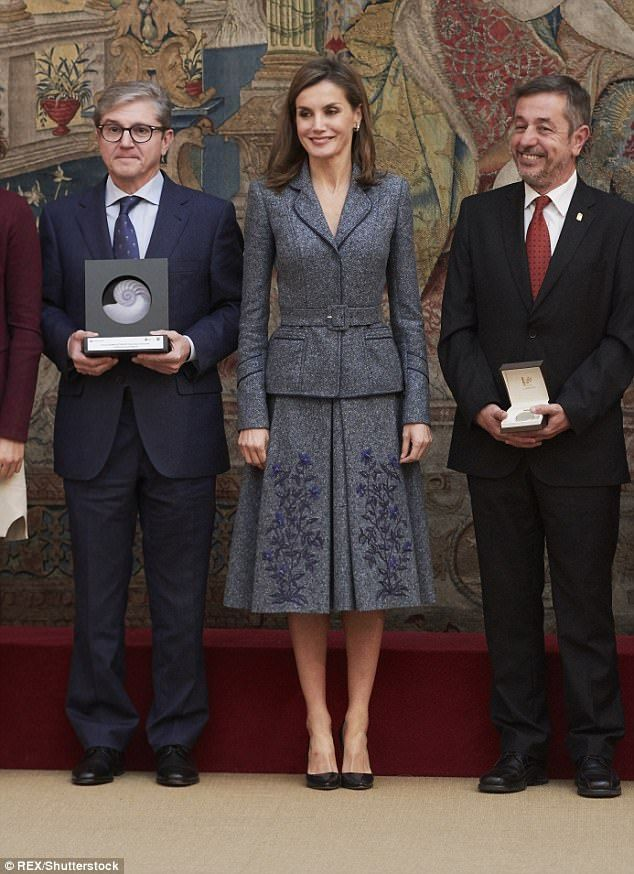 The Spanish Queen looked sharp in a grey tweed belted jacket and knee-length skirt...